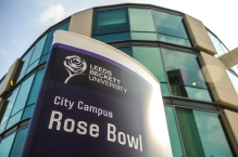 Curved totem signage at the Rose Bowl