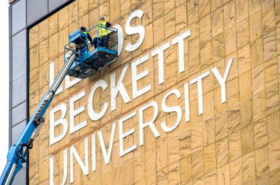 Front lit LED lighting being fitted to the main Leeds Beckett building