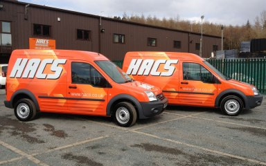 HACS Transit Connect graphics - orange printed wrap panels to orange vans