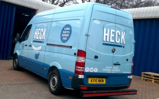 Heck full light blue van wrap by Ad Bell