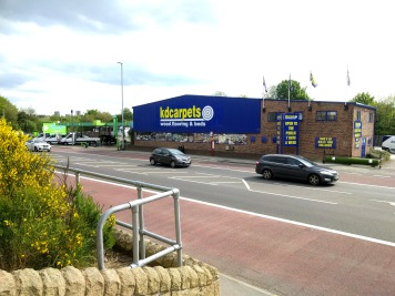 Large fascia signs for KD Carpets by Ad Bell