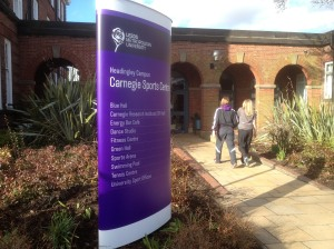 Exterior curved totem sign for Carnegie Sports Centre
