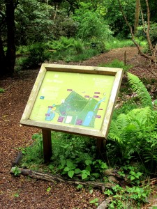 Wayfinding signage with a natural wooden frame
