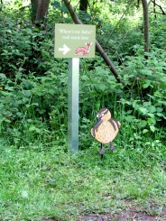 Panel and post sign at Castle Howard, complete with cartoon duck!