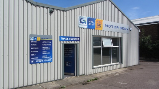 Fascia signage fixed to cladding