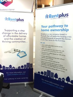 Retractable banner stands with RentPlus branding
