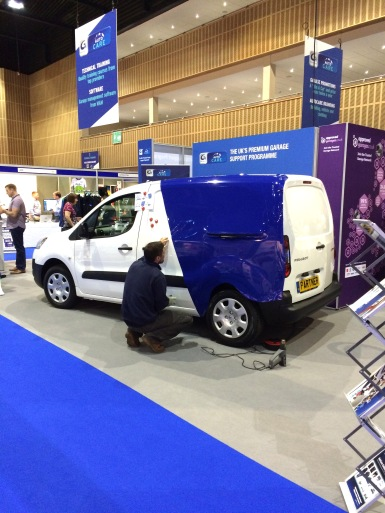 Group Auto vehicle graphics being applied on the Group Auto exhibition stand