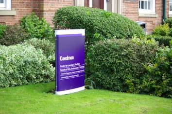 Curved totem signage for Leeds Beckett Caedmon