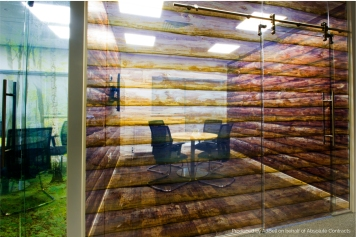 Log cabin themed office meeting room