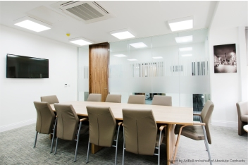 Frosted vinyl window manifestations in an office meeting room