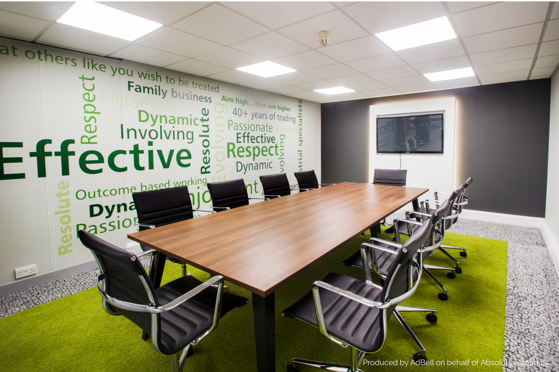 lettering to wall of a modern boardroom ad bell sign systems