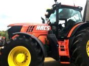 The finished tractor showing the orange wrap along with additional HACS and John Deere decals over the top